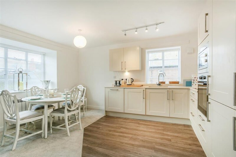 The modern kitchen with dining table and chairs