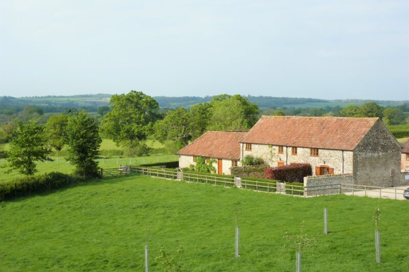 View towards the cottage which is surrounded by rolling countryside