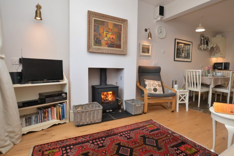 Relax by the wood burner in the lounge