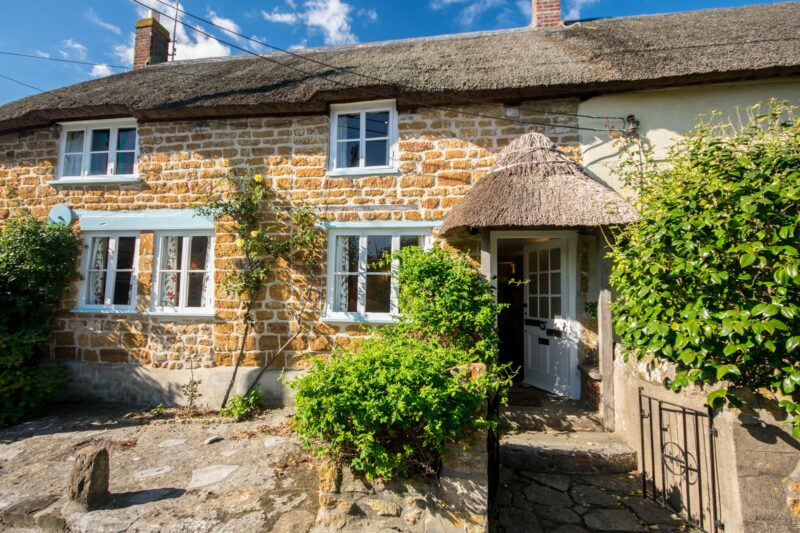 Looking towards this charming thatched cottage