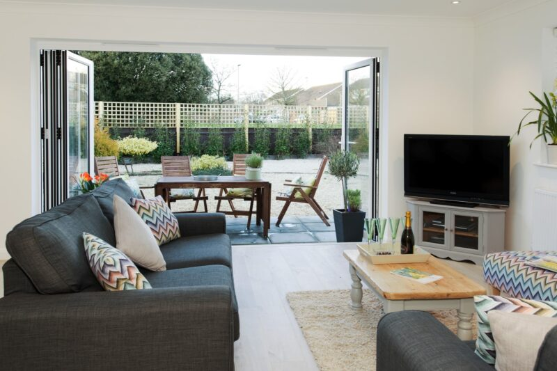 Lounge with bi-fold doors to patio area